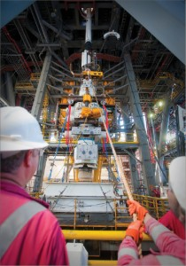 The capping stack BOP is skidded onboard the Transocean Discoverer Inspiration to mate with the Vetco and EDS control panel on top of the moon pool in July 2010. Source: BP.com