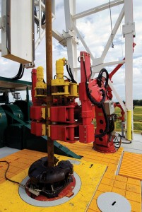 Figure 2: Automated tools, such as an automated floor wrench, remove workers from performing high MSD-risk tasks. Courtesy of Canrig Drilling Technology