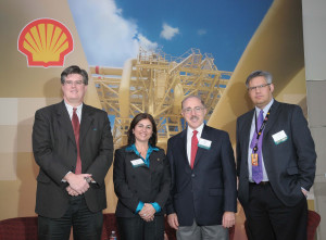 Shell scientists take a closer look at key technologies developed at the Shell Technology Center Houston during its recent Innovation Summit. From left, Scott Meyers, general manager of IT innovation and center of expertise for Shell's technical and competitive IT (TaCIT) group, on high-performance computing; Selda Gunsel, VP global commercial technology, on mobility; Sergio Kapusta, chief scientist materials and corrosion, on nanotechnology; and Jonathan Crane, VP wells technology deployment, on wells technology.