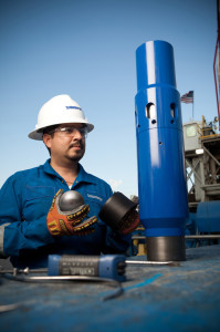 A Schlumberger engineer performs quality assurance verification on the Falcon multistage stimulation system for uncemented wells. The ball shown is the new ELEMENTAL high-performance degradable alloy ball.