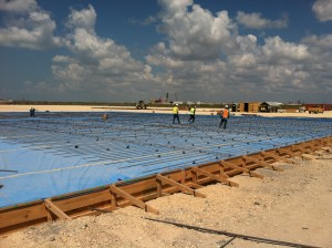 Construction workers build the warehouse and yard at Kiewit's Ingleside facility near Corpus Christi, Texas. The facility will provide for the storage, maintenance and testing needs of MWCC's ECS plan.