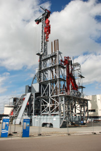 Bauer Deep Drilling's 2,000-hp, AC-powered walking rig features a hands-free coupling system for rig-up.
