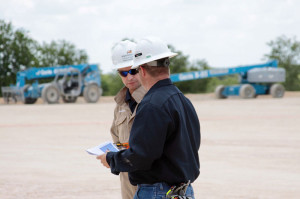 "Derek Cardno, VP of Drilling and Completions for BHP Billiton, visits a drilling site in the Eagle Ford, where the operator is drilling development wells. ""We're training our engineers and field crews in lean techniques and how to identify ways to take time out of our business,"" Mr Cardno said. ""It's not by doing things recklessly. It's by having a really good plan, the right tools, the right people, crews being motivated to execute that plan and then do it even better the next time."""