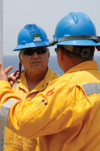 George Silva, Captain of the Noble Bully I drillship, communicates with a crew member on the rig. Noble has developed several training courses addressing the way its offshore crews interact with each other and with their work environment.