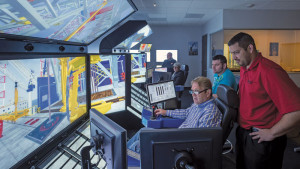 John Ash (center), Assistant Rig Manager for the Noble Mick O'Brien, uses the drilling simulator at Noble's NEXT Center near Houston. Noble uses simulator-based training to coach employees in skills such as listening, communication and stress management.
