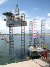 The KFELS B Class jackup can drill wells up to 30,000 ft with a cantilever that can skid out 70 ft from the edge of the hull.