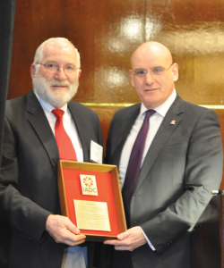 IADC President and CEO Stephen Colville (right) presents an IADC Exemplary Service award to Joe Hurt during the IADC Health, Safety, Environment & Training Conference on 3 February in Houston. Mr Hurt retired from IADC last year.