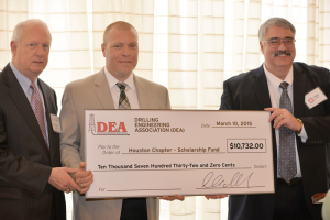 IADC's Bob Warren (left) and Chevron's Ben Bloys (right) presented the donation to Jeff Kessler, IADC Houston Chapter Chairman.