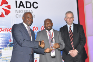 In June, the IADC Nigeria Chapter hosted a safety awards event to recognize superior industry performance. Winners included Idigo Drilling, Oando Energy Services, Depthwize Nigeria, Cardinal Drilling Nigeria, Shelf Drilling Nigeria and Pacific International Drilling West Africa. KCA Deutag Nigeria received the award for best HSE performance in 2014. Pictured from left are Sola Falodun, IADC Nigeria Chapter Chairman; Tokunbo Akinuli, Chapter Secretary, who accepted the award on behalf of KCA Deutag; and Markus Droll, Vice President Nigeria & Gabon, Shell Exploration and Production Africa.
