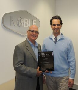 Derek Morrow (left), IADC Regional Director for Australasia, presents Kirk Atkinson of Noble Drilling with the Offshore Winners Award plaque in Perth on 1 July
