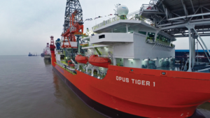The Opus Tiger 1 has completed sea trials and is currently located in Shanghai. The rig can operate in water depths ranging from 300 to 5,000 ft and can drill to a maximum depth of 32,800 ft. The rig is part of Opus' strategy to focus on the midwater drilling market.