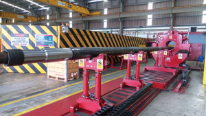A Halliburton VersaFlex expandable liner hanger is prepared for offshore deployment. Advances in the company's expandable liner technology include the Big Bore system, which has seen multiple deployments in Brazil's pre-salt formations.