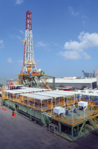Grey Wolf's 3,000-hp AC Rig 901 undergoes commissioning after construction in Jebel Ali, Dubai. The rig is designed for high-pressure, high-temperature (HPHT) drilling. Onshore drilling operations in the Middle East often resemble today's high-spec HPHT offshore drilling applications and thus require long-term contracts to make the operations viable for both the operator and rig contractor.