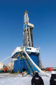 """Parker Drilling's Rig 258 drills in Kazakhstan, where Chevron holds stakes in the nation's two biggest oil-producing fields — Tengiz and Karachaganak. The operator is seeing efficiency at a high across all service sectors, driven by companies seeking to establish an edge in this ultra-competitive market. For contractors, they're increasingly looking for ways to help operators in the completion process, as well as how to take things off the critical path, such as offline cementing or making up casing offline. """"They're starting to look at a lot more flat time type of opportunities,"""" said Kim McHugh, General Manager of Drilling and Completions for Chevron. Photo courtesy of Chevron."""