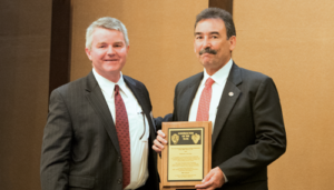 Mike Garvin (right) receives the 2016 IADC Contractor of the Year Award from Clay Williams, President and CEO of National Oilwell Varco, on 4 November in Scottsdale, Ariz.