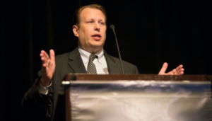 Stephen Beck, Senior Director and Head of North American Oil & Gas Supply Forecasting for IHS Markit, speaks on a panel session at the 2017 IADC Drilling Onshore Conference on 18 May in Houston. Mr Beck explained that rising service costs will likely slow US onshore production in 2018, despite considerable activity ramp-up this year.