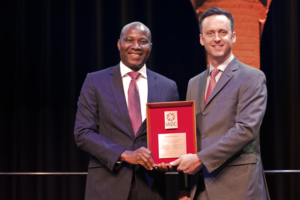 IADC President Jason McFarland (right) presents the IADC Exemplary Service Award to Sola Falodun, General Manager, Drilling and Completion Systems for OES Energy Services.