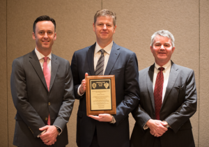 Tom Burke (middle), President and CEO of Rowan Companies, received the 2017 IADC Contractor of the Year award from IADC President Jason McFarland (left) and Clay Williams, President and CEO of National Oilwell Varco, at the 2017 IADC Annual General Meeting in Austin, Texas, on 10 November.