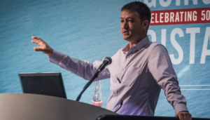 Mete Mutlu, Senior Subsea Engineer at Transocean, speaks on 1 May at OTC 2018 in Houston, Texas about the University of Houston's successful test of a physics-based approach to monitoring BOP leaks.