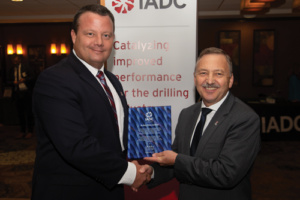IADC Advanced Rig Technology (ART) Committee Chairman Robin Macmillan (right), NOV, received an IADC Exemplary Service Award at the 2018 ART Conference in September in Austin, Texas. The award was presented by ART Vice Chairman Trent Martin, Transocean.