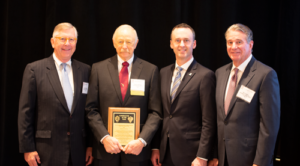 Trent Latshaw (second from left), President of Latshaw Drilling Co, was named 2018 IADC Contractor of the Year. Mr Latshaw received his award on 9 November at the 2018 IADC Annual General Meeting in New Orleans from Loren Singletary (left), Chief Investor and Industry Relations Officer for NOV; Jason McFarland (second from right), IADC President; and Bill Crabbe, Chief HSE Officer for NOV.