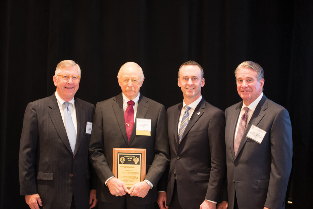 Trent Latshaw (second from left) accepted his IADC Contractor of the Year award at the 2018 IADC Annual General Meeting in New Orleans. From left are Loren Singletary, NOV Chief Investor & Industry Relations Officer; Mr Latshaw; IADC President Jason McFarland; and Bill Crabbe, NOV Chief Health, Safety and Environment Officer.